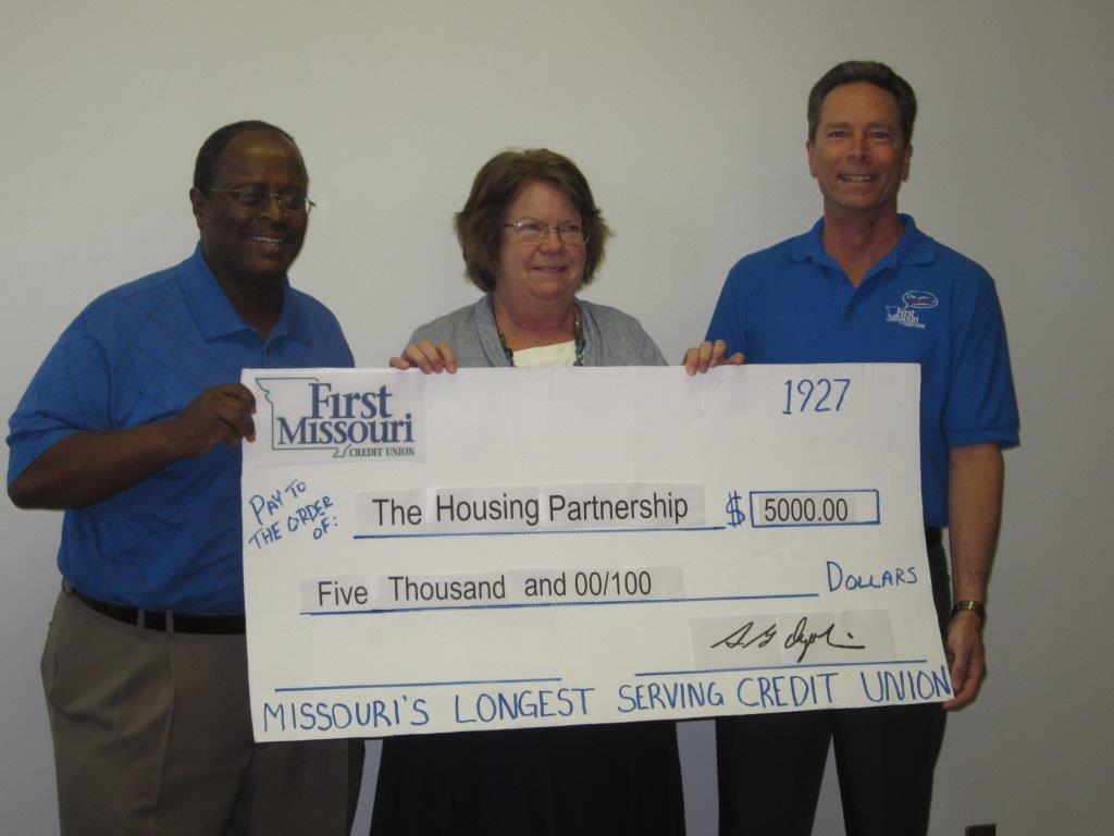 $5,000 grant awarded to The Housing Partnership. FLTR: Reginald Scott, Kate Reese, and Steve Ogolin.